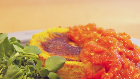 Spicy egg burger, served with cumin tomato sauce and watercress